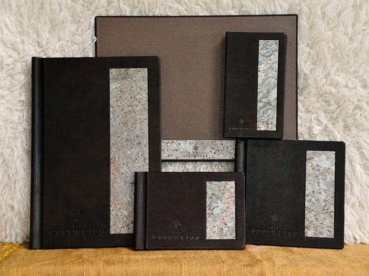 Kartenserie - Wein-, Speise- und Getränkekarte, Rechnungskassette, Leder mit Steinfurnier-Intarsie und Prägung